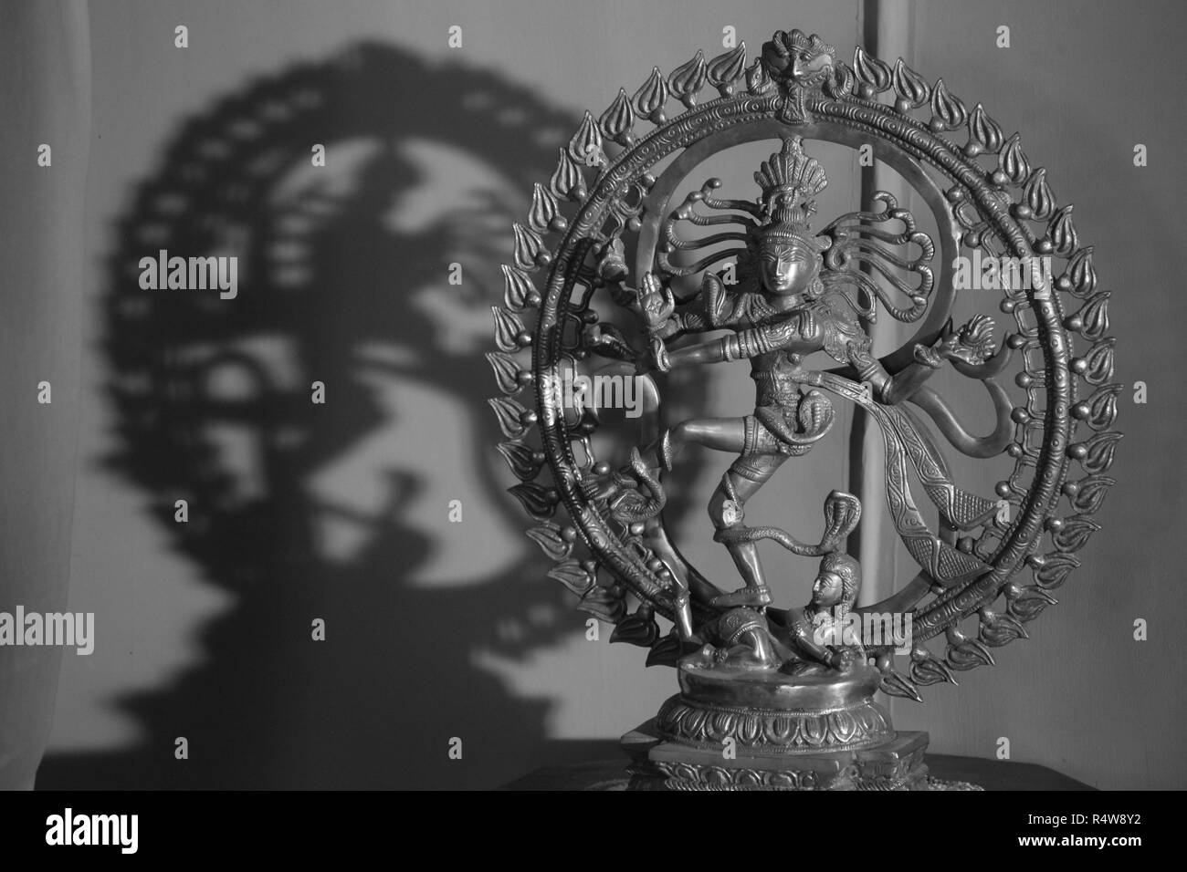 An antique metal sculpture of the dancing god Shiva also known as the Natraj or Natraja, woshipped by dancers following traditional danceforms of Indi - Stock Image