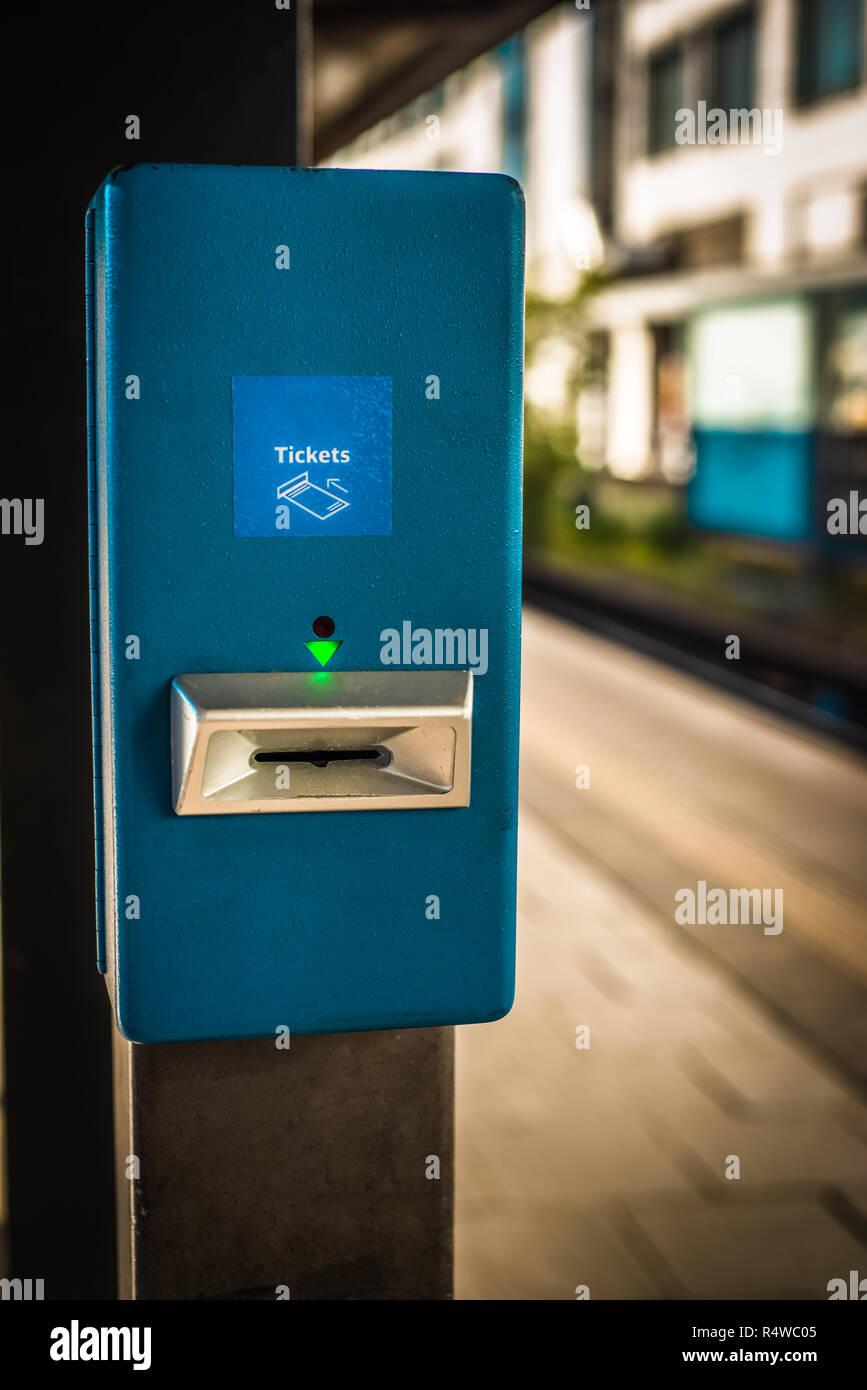 Ticket Validation Stamp Machine on a Platform at a Train Station - Stock Image