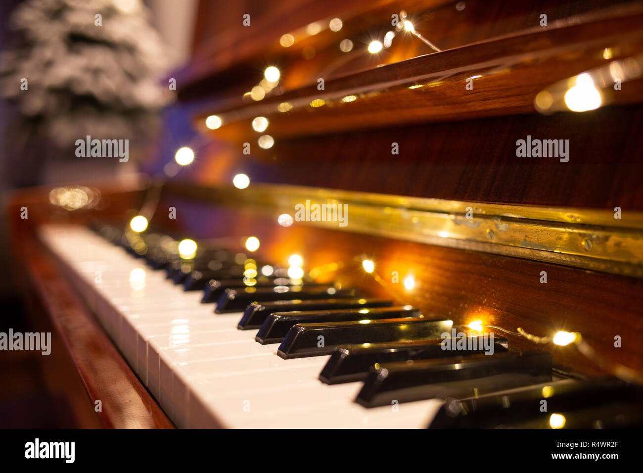 Piano keyboard illuminated with christmas lights  Romantic
