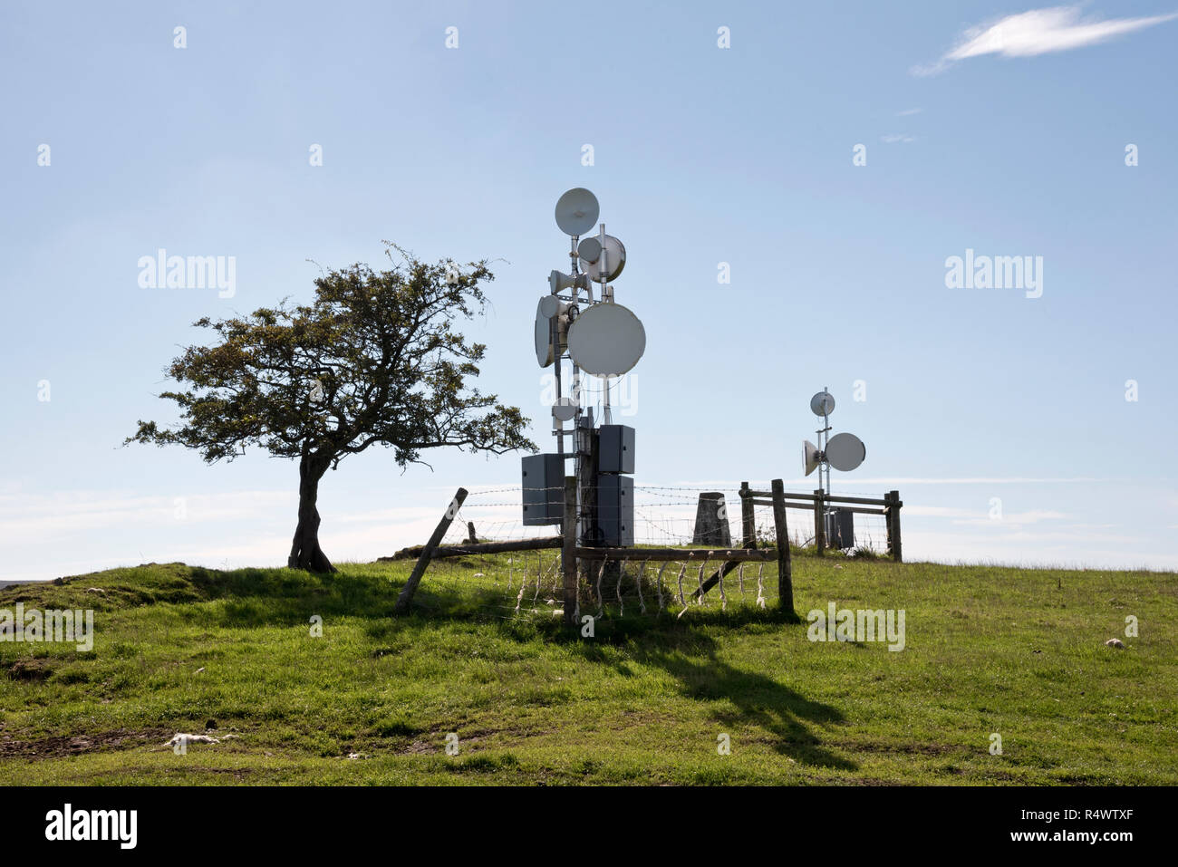 Telecommunications mast and dishes on a hill top, The Betchcott Hills, The Long Mynd near All Stretton, Shropshire, UK - Stock Image