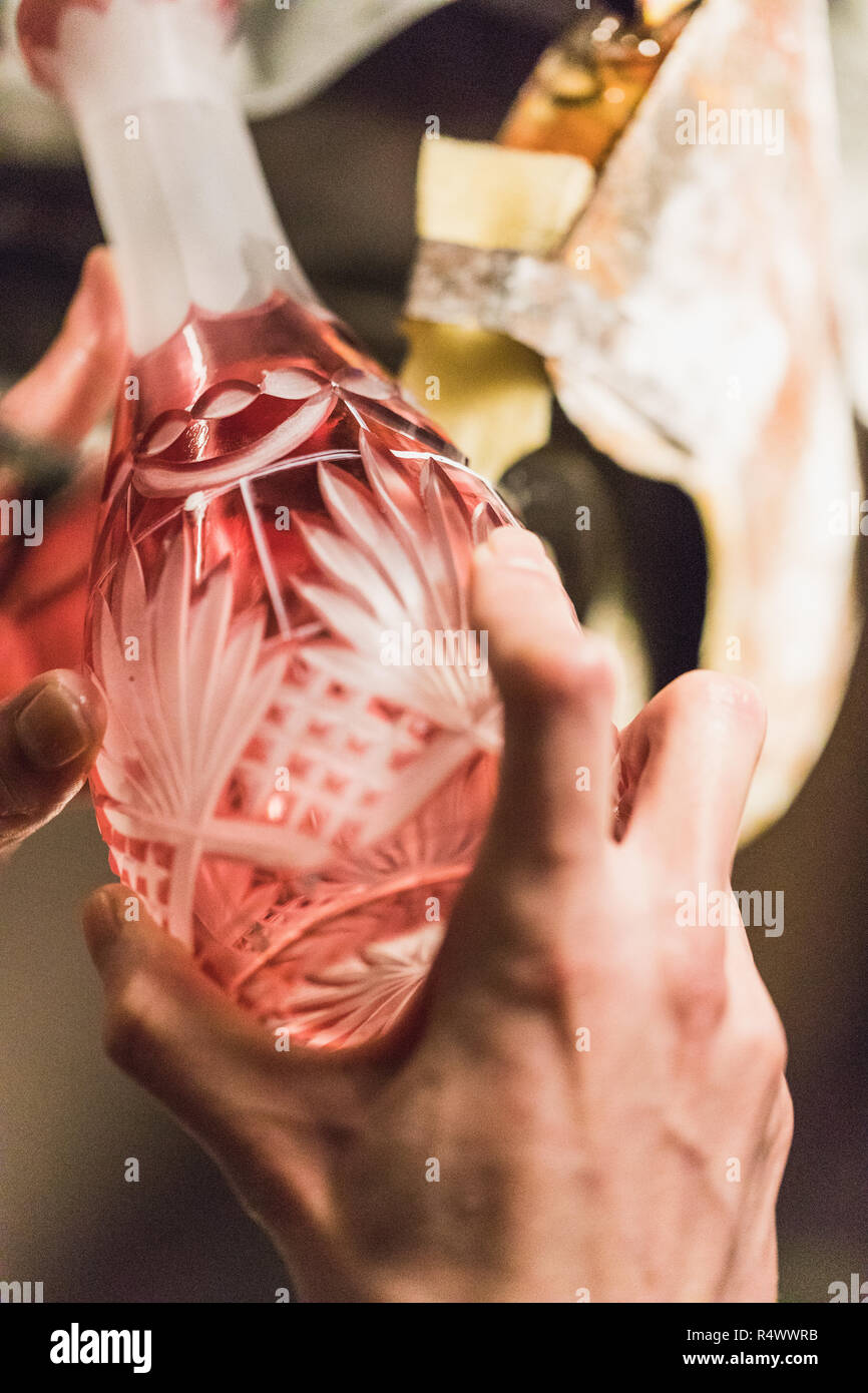 closeup of man grinding or cutting a colorful glass vase, germany - Stock Image