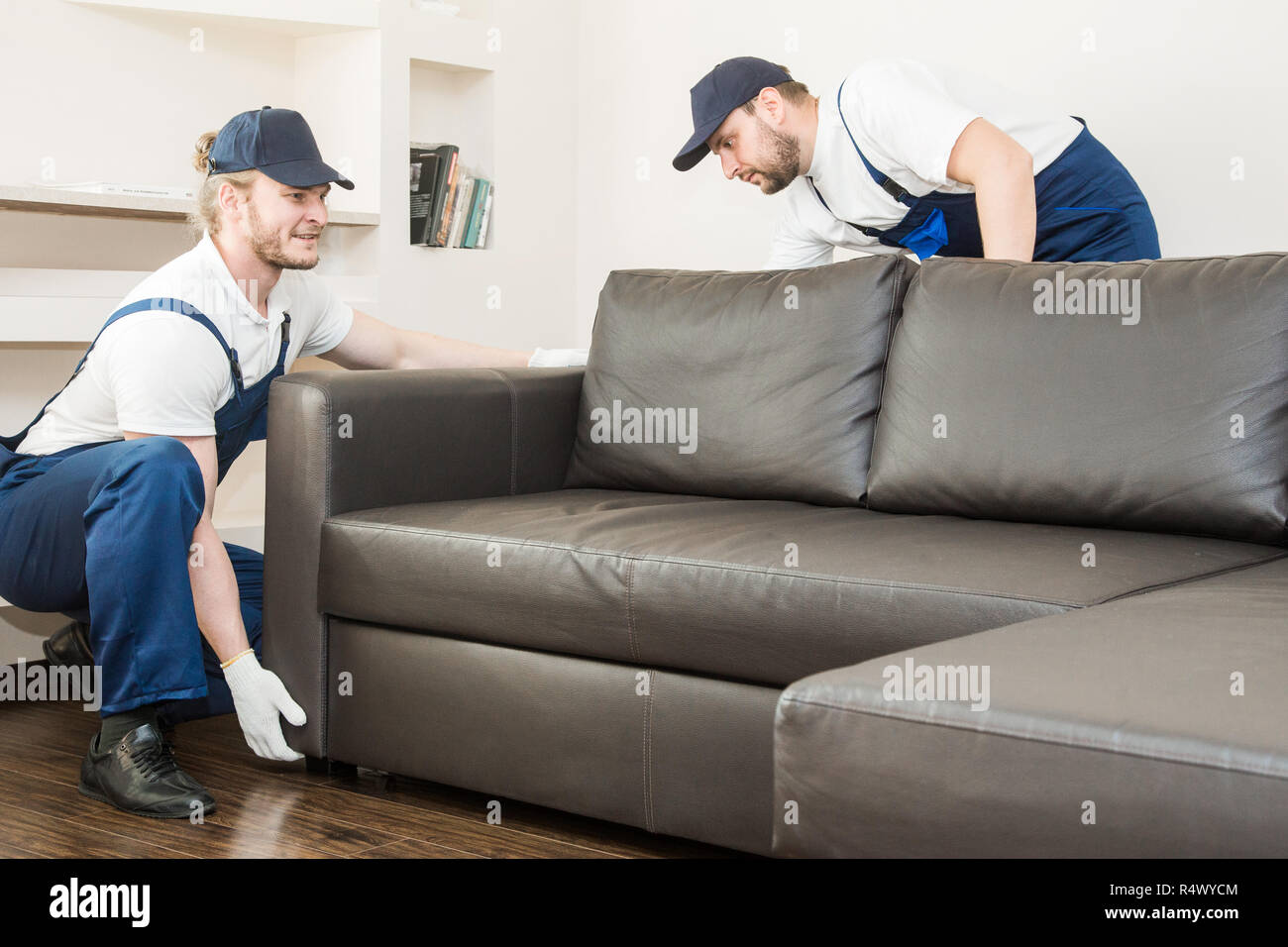 Delivery man move furniture carry sofa for moving to an ...