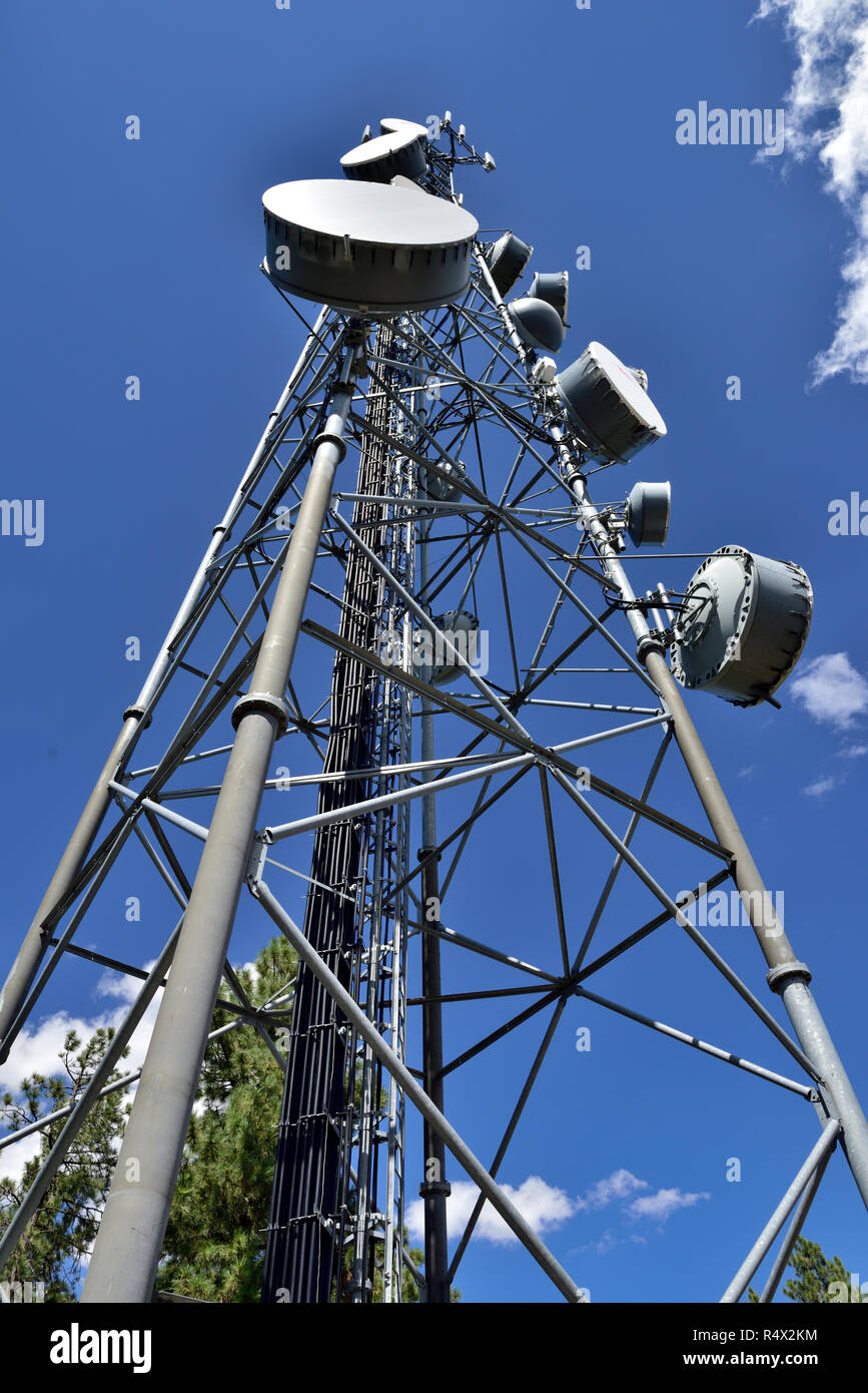 Communication tower with microwave and cell phone aerials Stock Photo