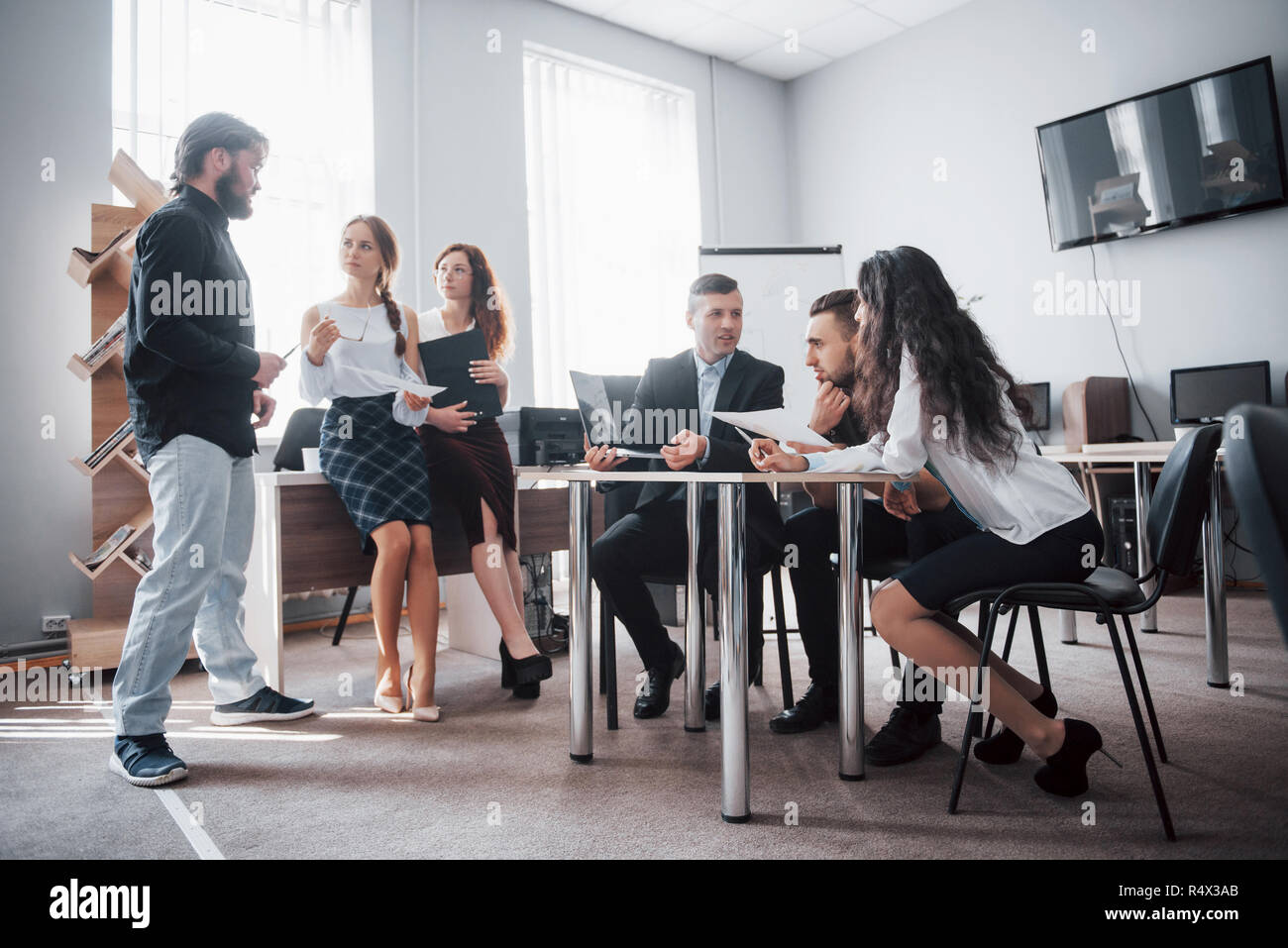Group of young business people working and communicating together in creative office Stock Photo