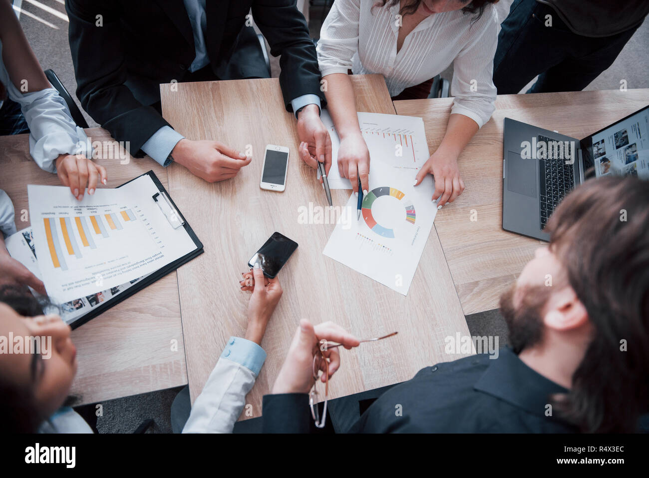 Working environment and discussion of a new project. Concept picture of economy, and money Stock Photo