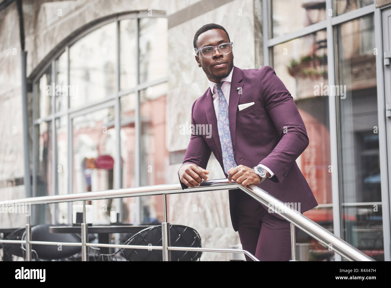A beautiful young African American who thinks about a serious idea. Confident in making business decisions - Stock Image