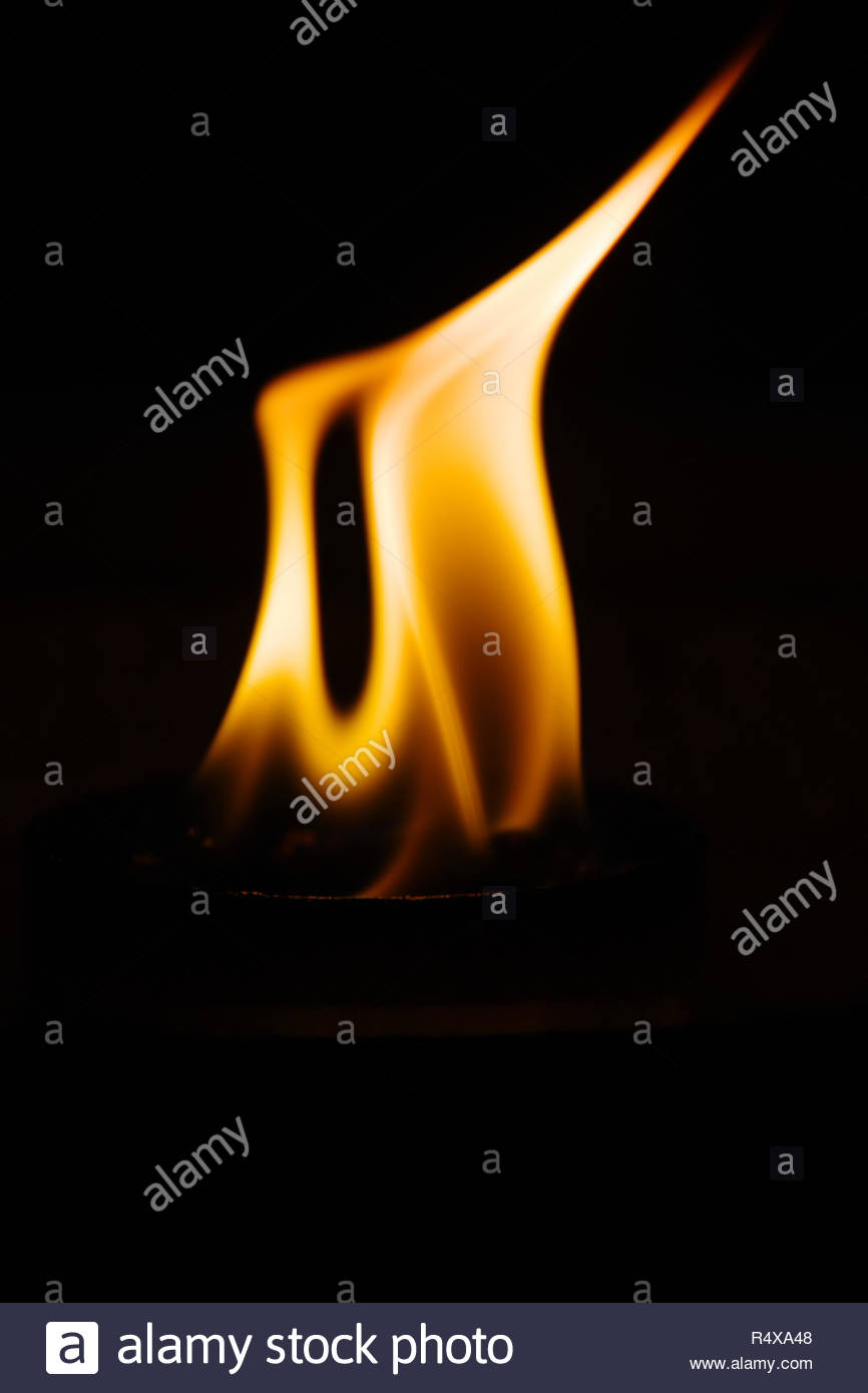 romantic smelting fire photographed at night - Stock Image