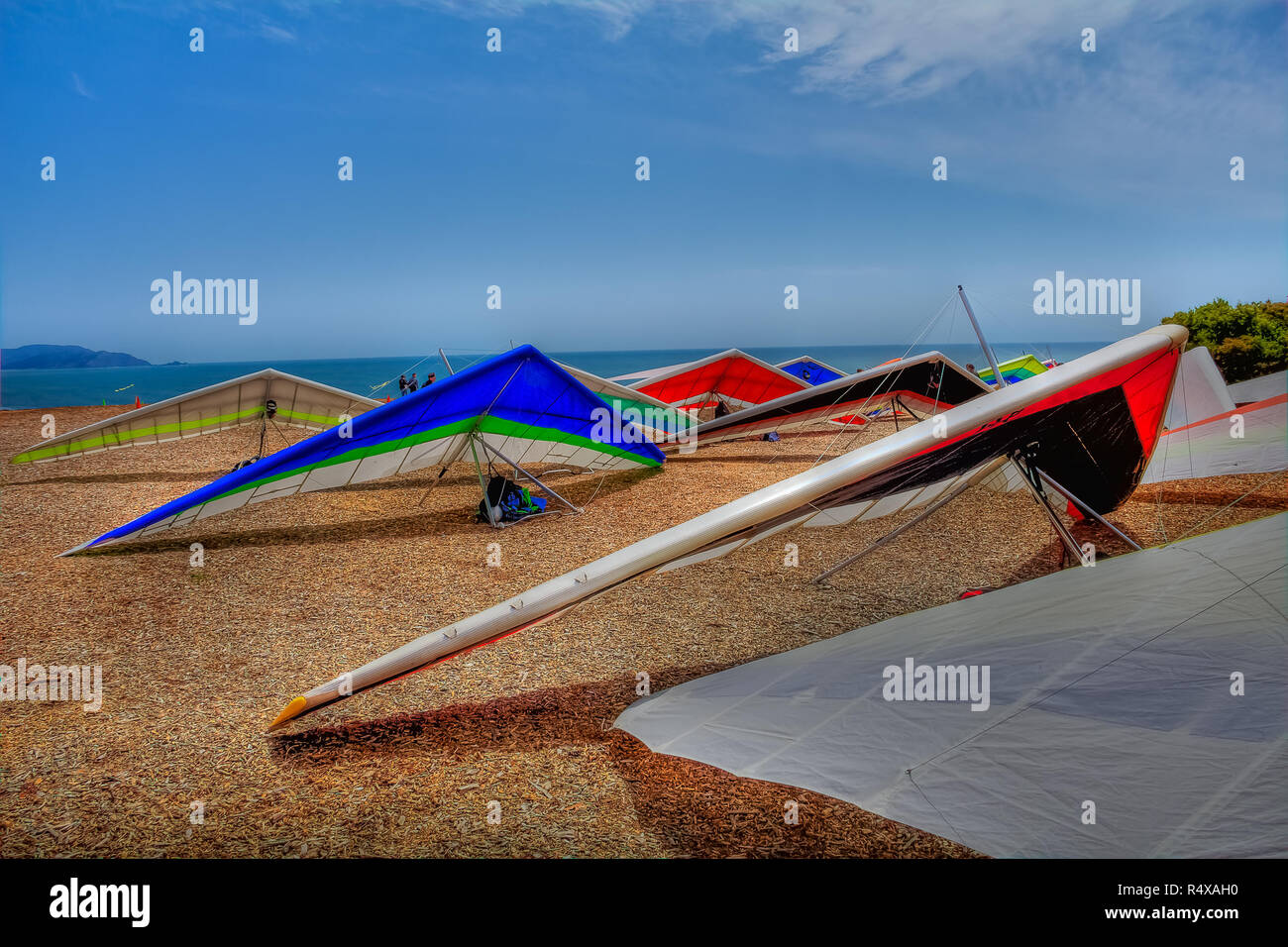 Colorful hang gliding wings lined up on top of a cliff at Fort Funston in San Francisco, one of the premier hang-gliding spots in the country Stock Photo