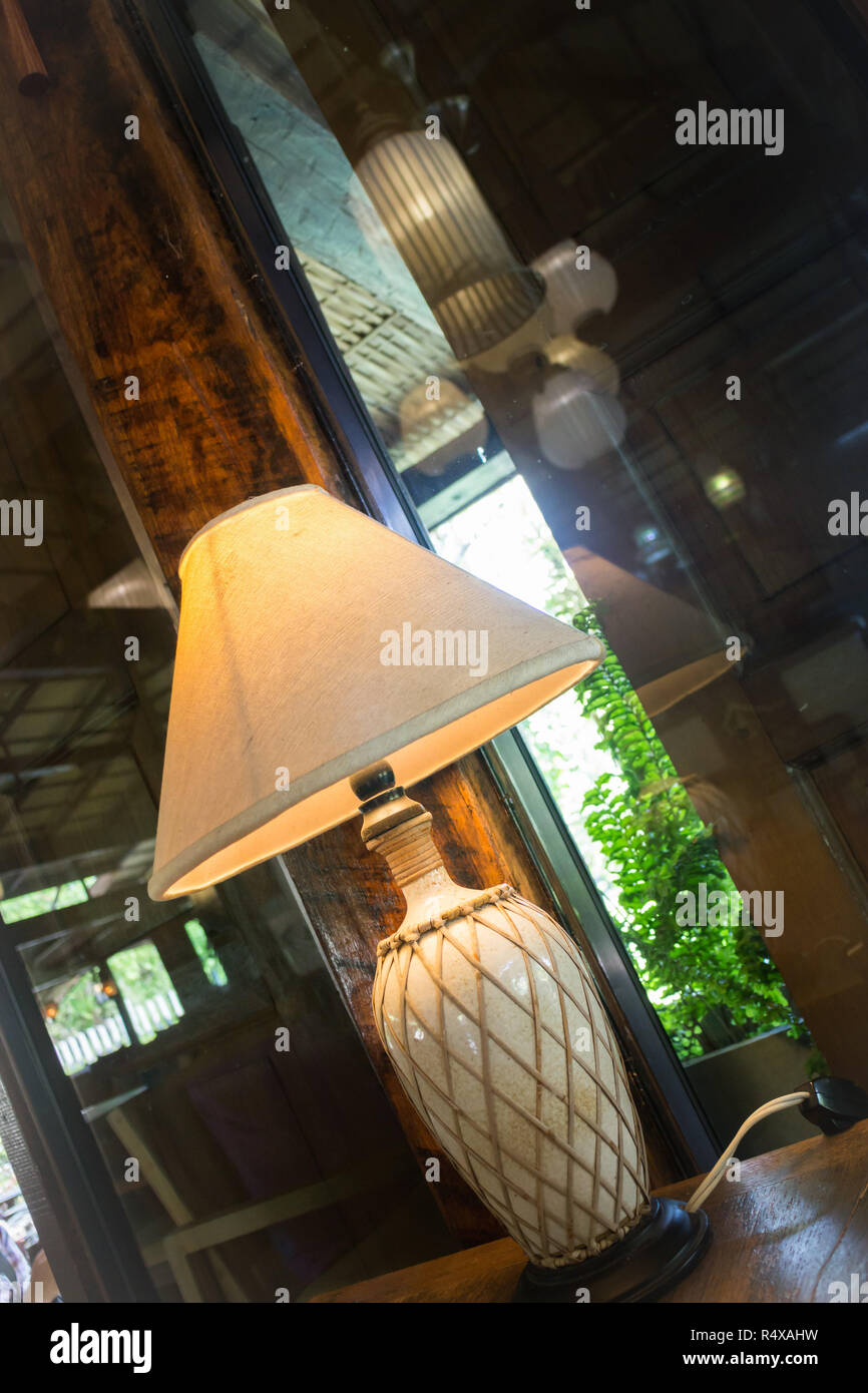 Bedside Lamp In Warm Tone Living Room - Stock Image