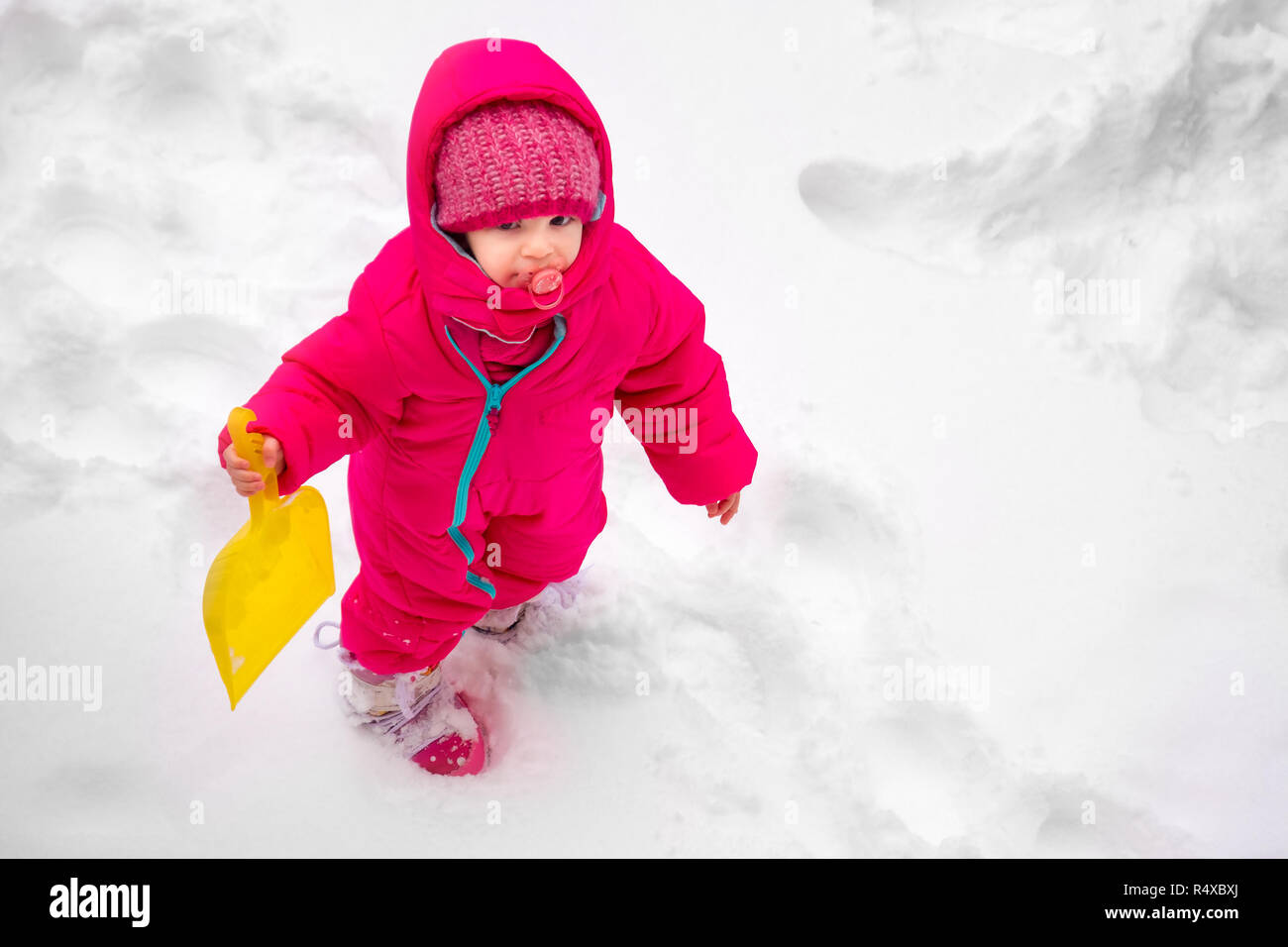 little baby girl view play snow wearpink child ski suit winter - Stock Image
