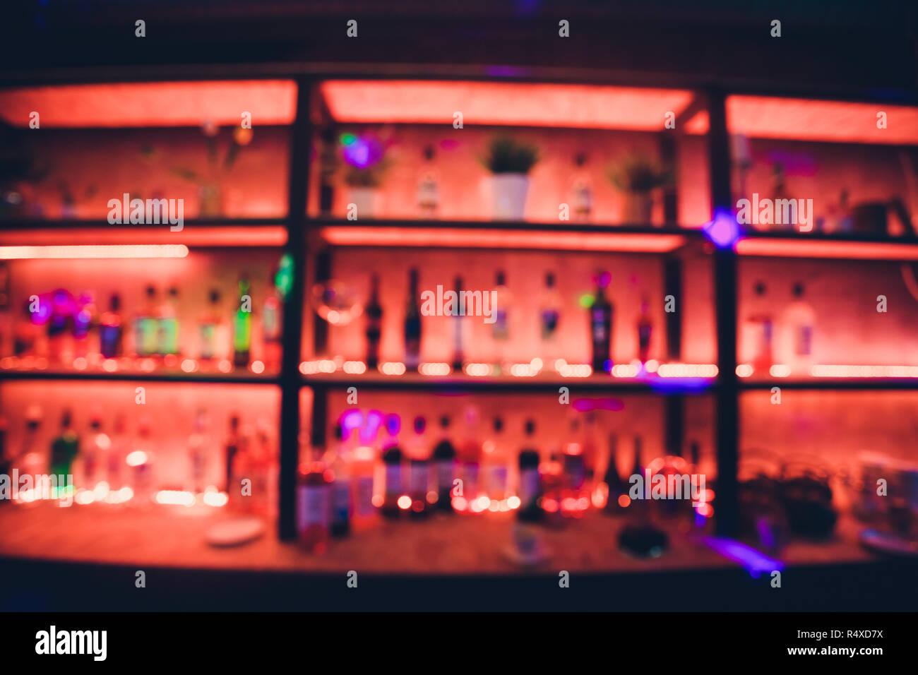 Blur Alcohol Drink Bottle At Club Pub Or Bar In Dark Party Night