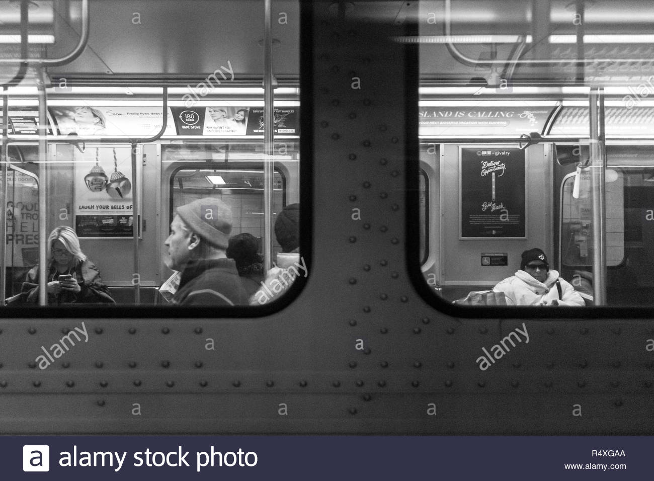 Toronto, Ontario, Canada-November 27, 2018: A view through the windows of a subway train. Everyday lifestyle of real city people as they commute in th Stock Photo