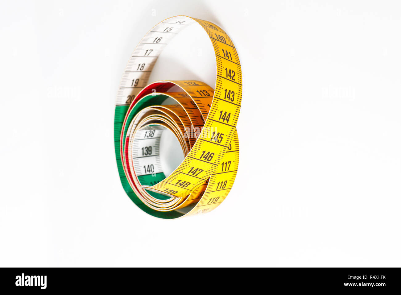 Close up of tape measure isolated on white background - Stock Image