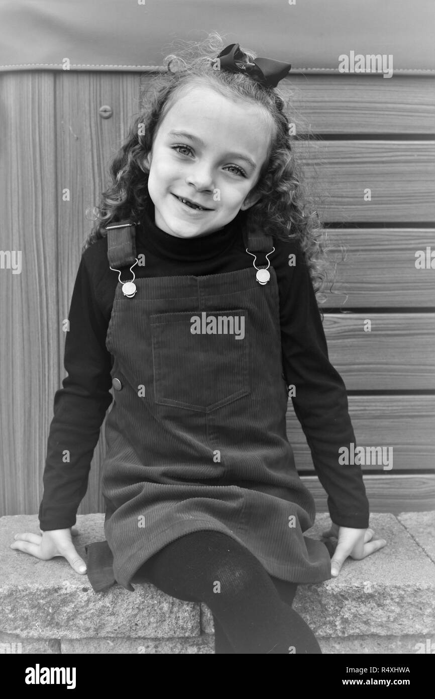 Young, photogenic, Caucasian girl, sat posing like a model - Stock Image