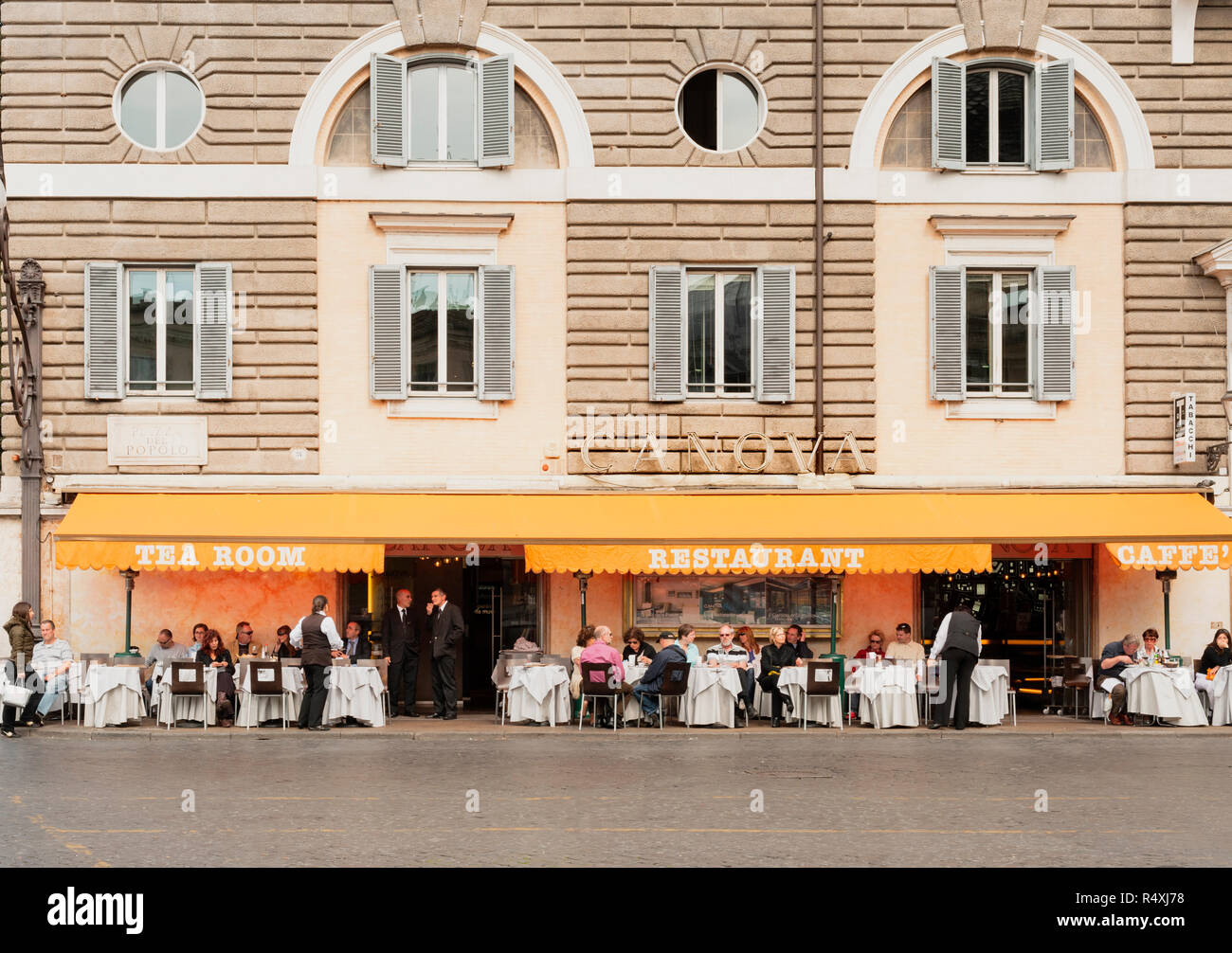 Dining alfresco, Diners and italian waiters at tables outside  the Restaurant Canova in Piazza del Popolo Rome - Stock Image