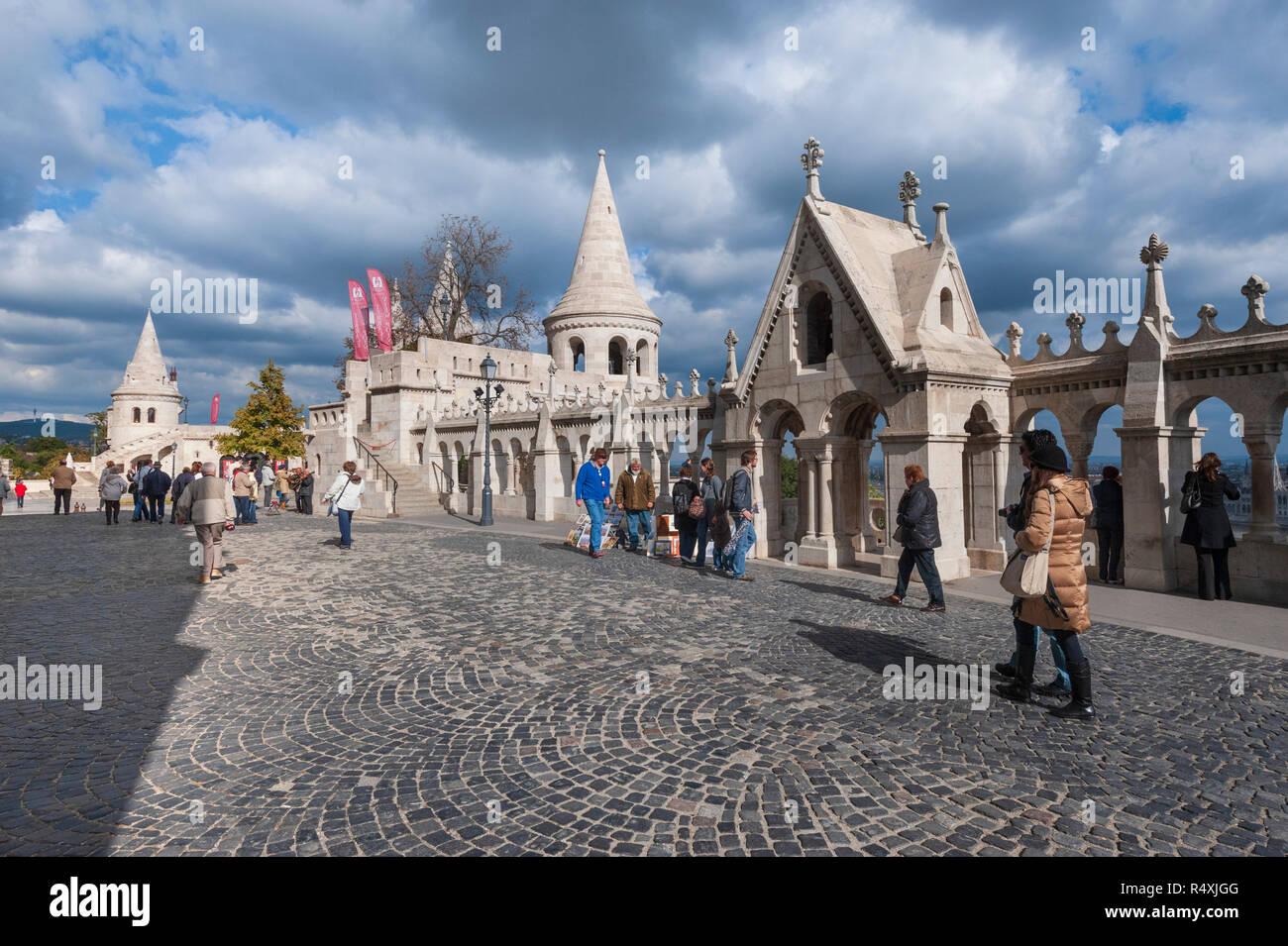 Budapest - tourists explore the Halászbástya or Fisherman's Bastion - Stock Image