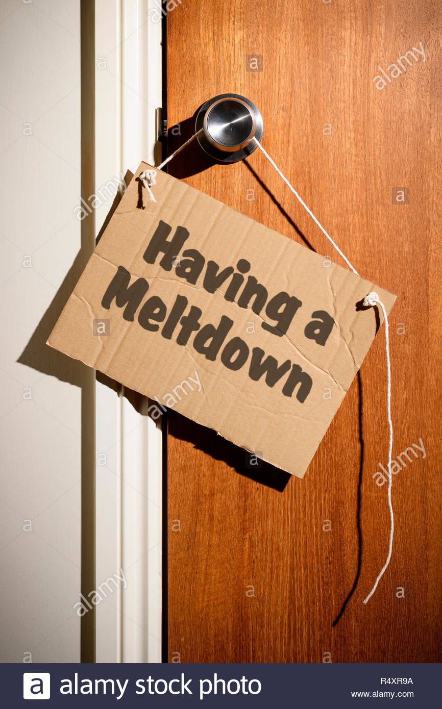 Having a Meltdown written on a makeshift sign hanging on the door handle, Dorset, England. - Stock Image