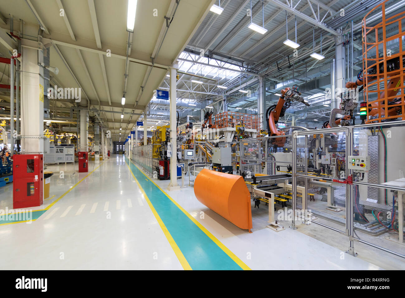 Conveyor for manufacture of cars. Automotive shop. Car Assembly plant. Car manufacturer - Stock Image