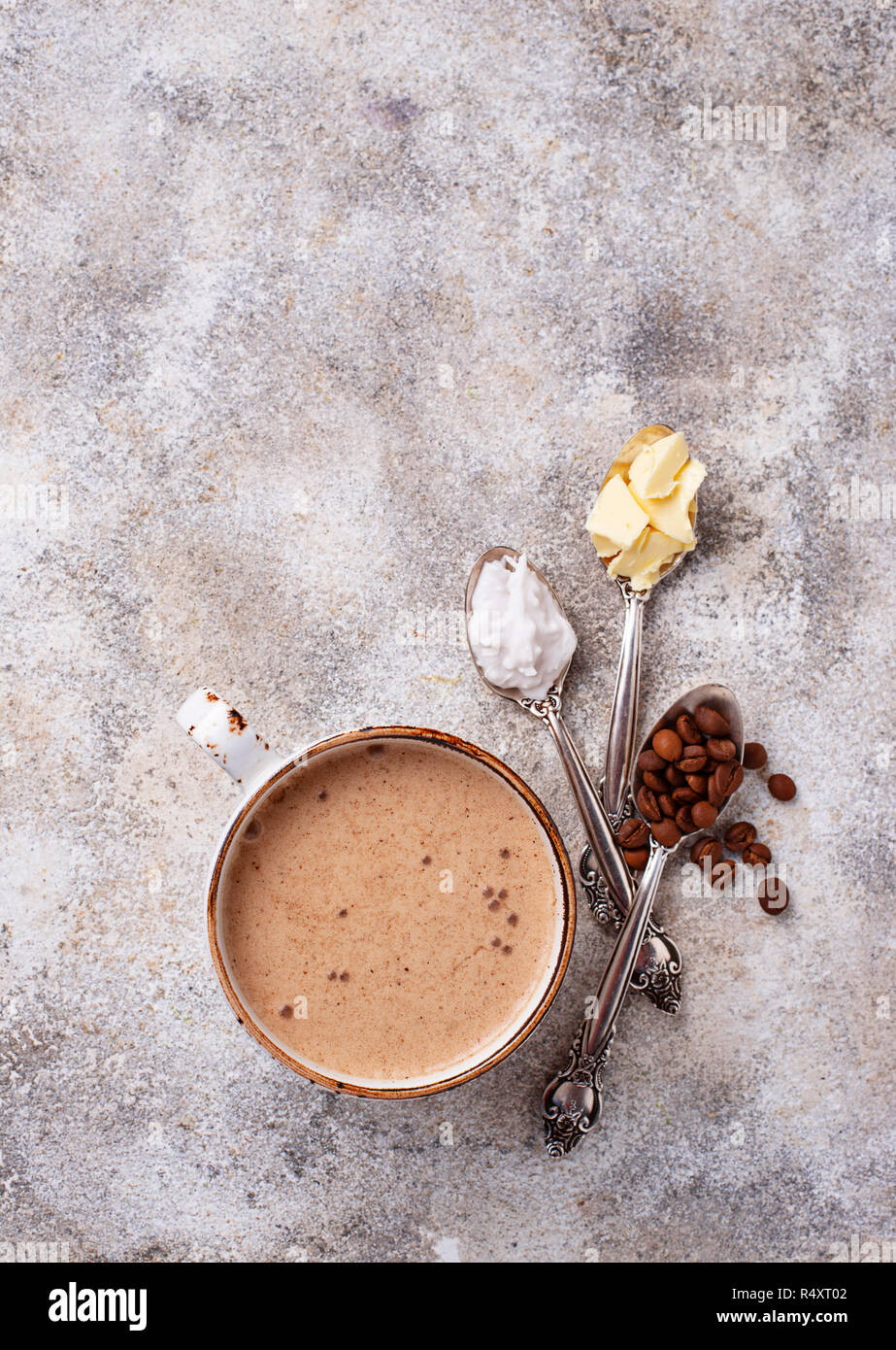 Bulletproof coffee with coconut oil and butter. Ketogenic low carb drink - Stock Image