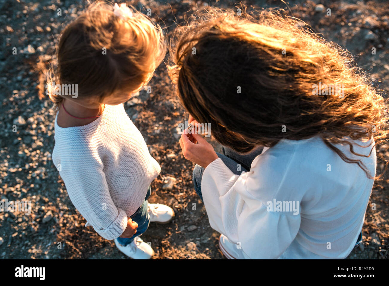 Mum and daughter having fun together outdoors. Stock Photo