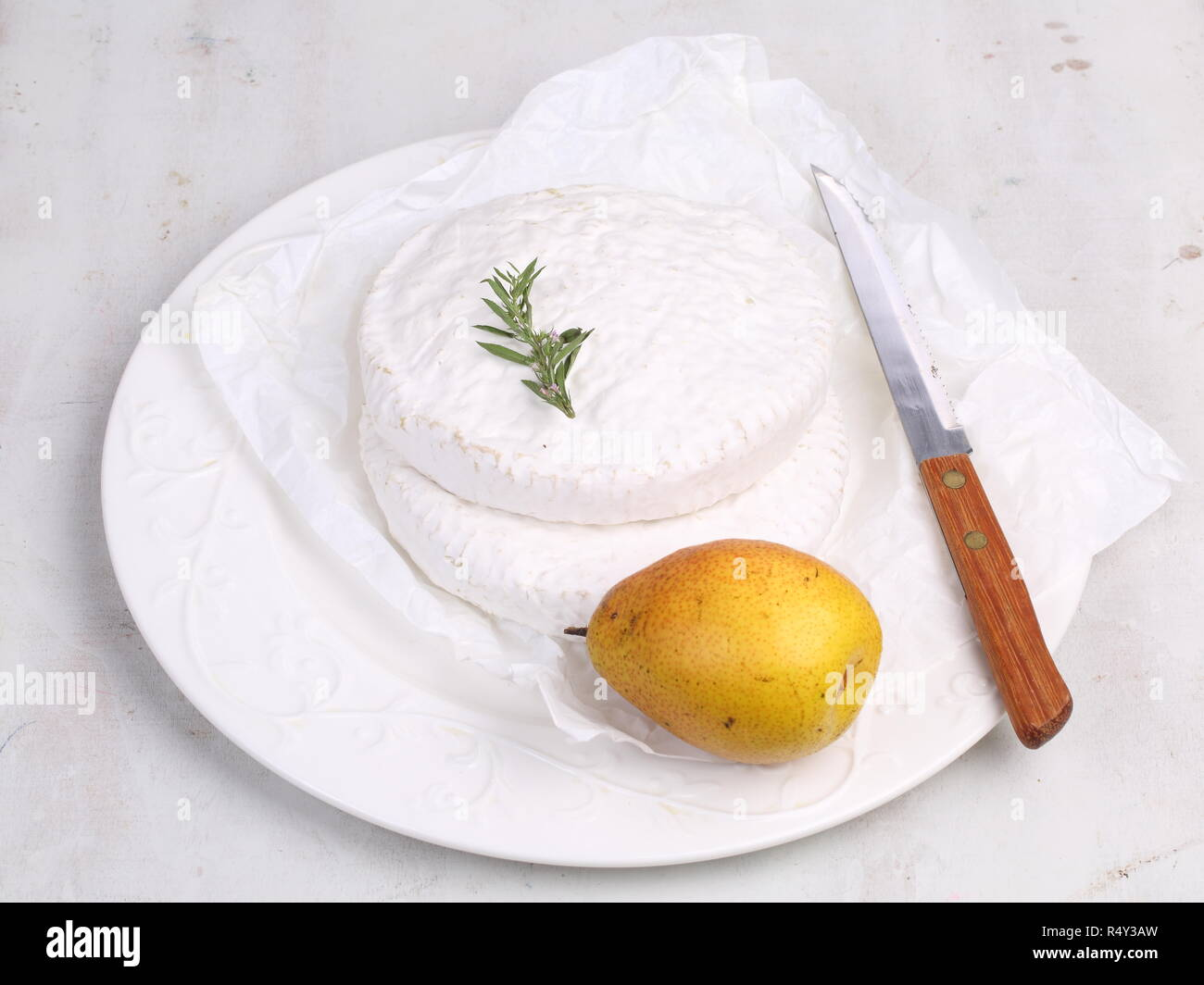 Camembert with pear on white background - Stock Image