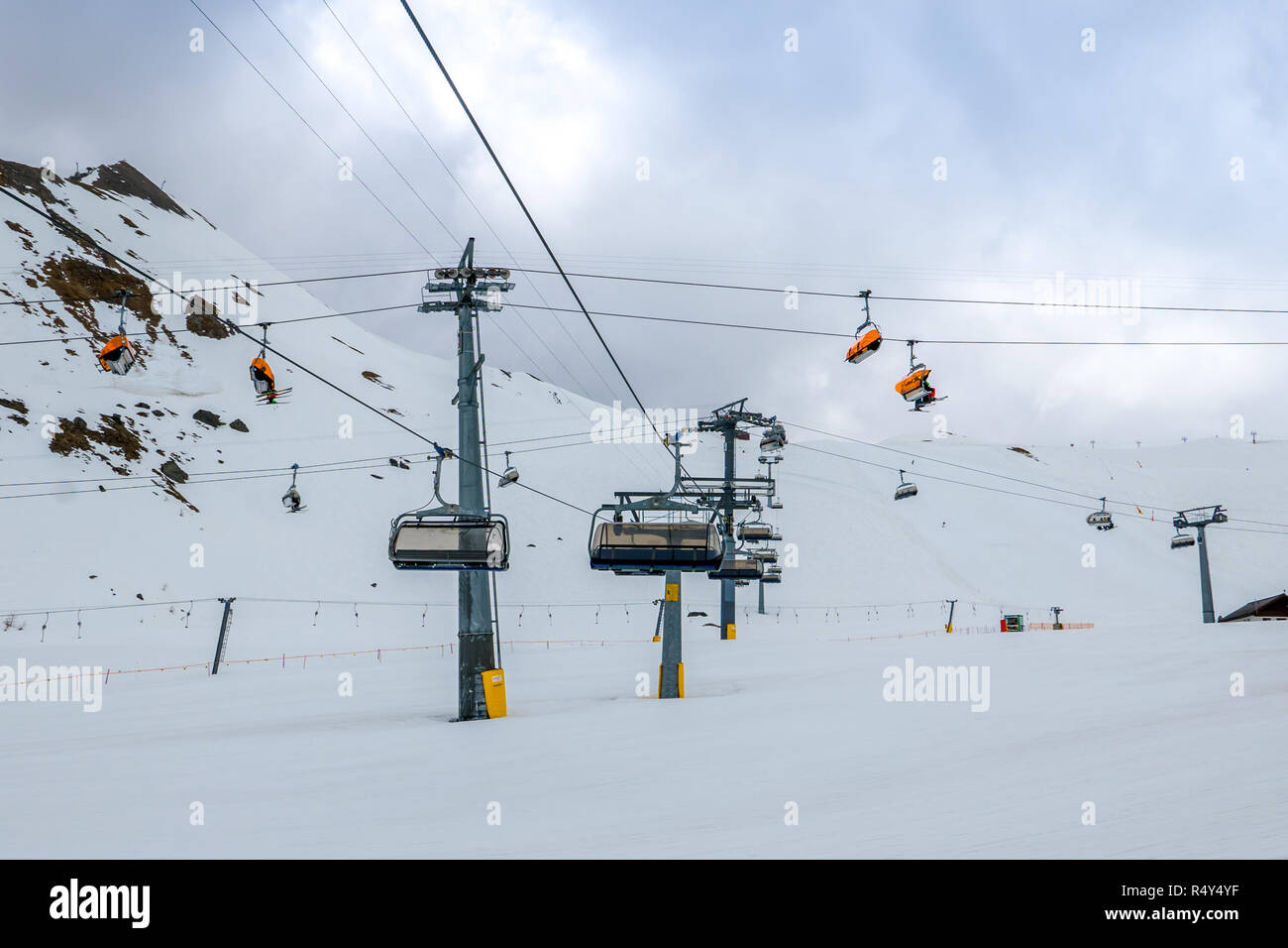 Multiple levels of chairlifts operating in ski resort Stock Photo