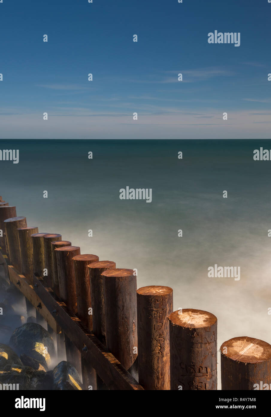 isle of wight costal seascape with groynes and breakwaters and calm seas - Stock Image