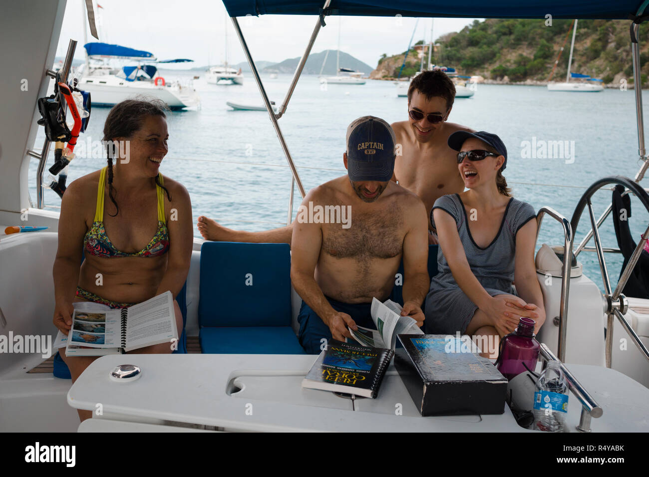 Friends having fun on rented boat during British Virgin Islands bareboat yacht  charter vacation.