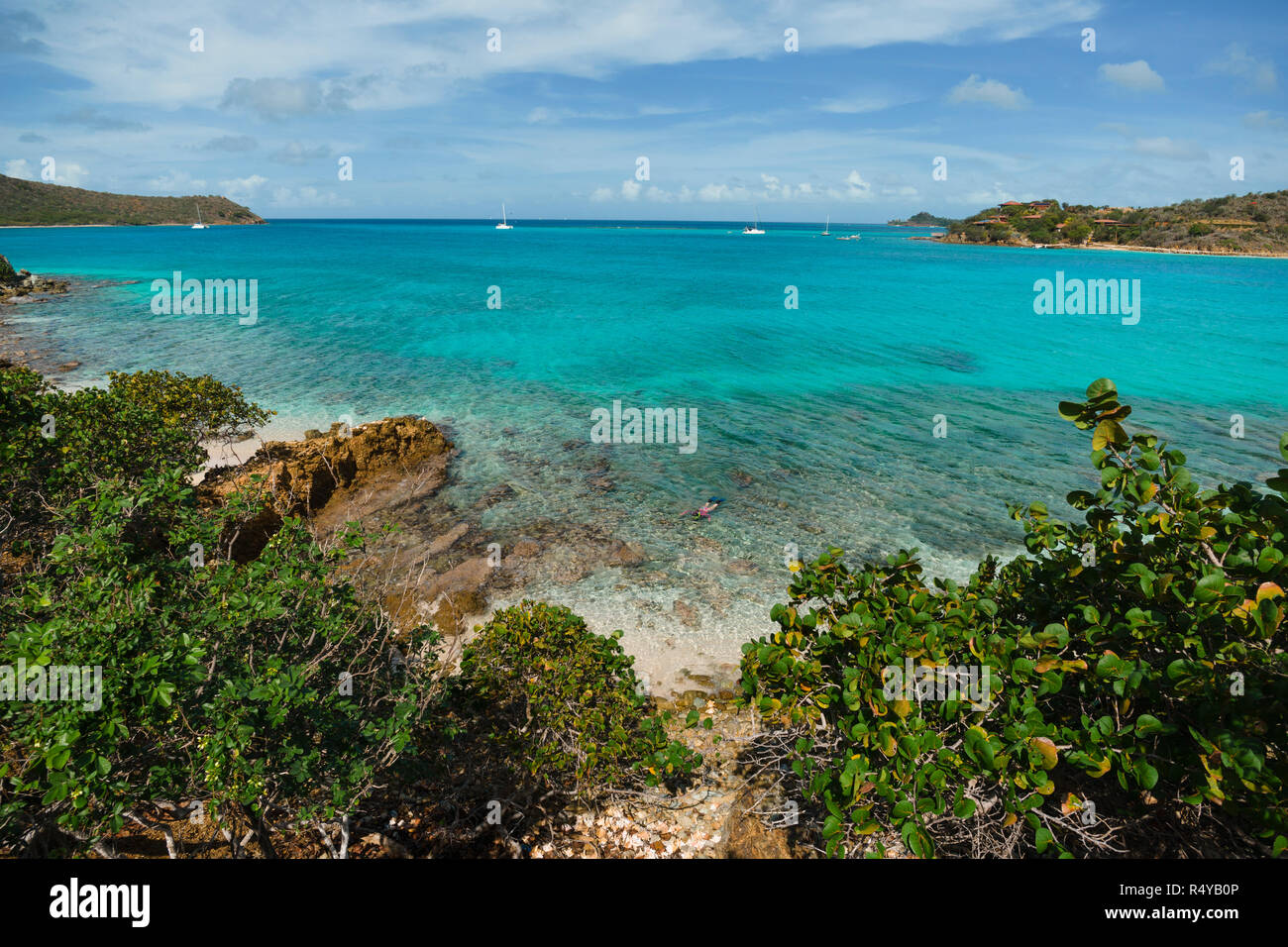 Snorkeling the pristine waters of Prickly Pear Island near Virgin Gorda in  the British Virgin Islands bareboat yacht charter vacation.