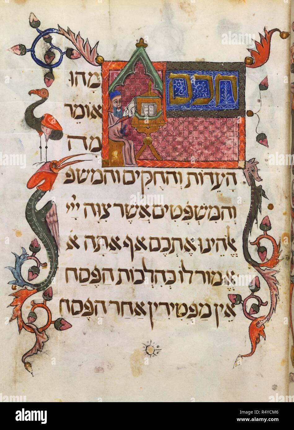 Illuminated folio from the 'Barcelona Haggadah'. Barcelona Haggadah. Catalonia, 14th century. Source: Add. 14761, f.34. Language: Hebrew. - Stock Image