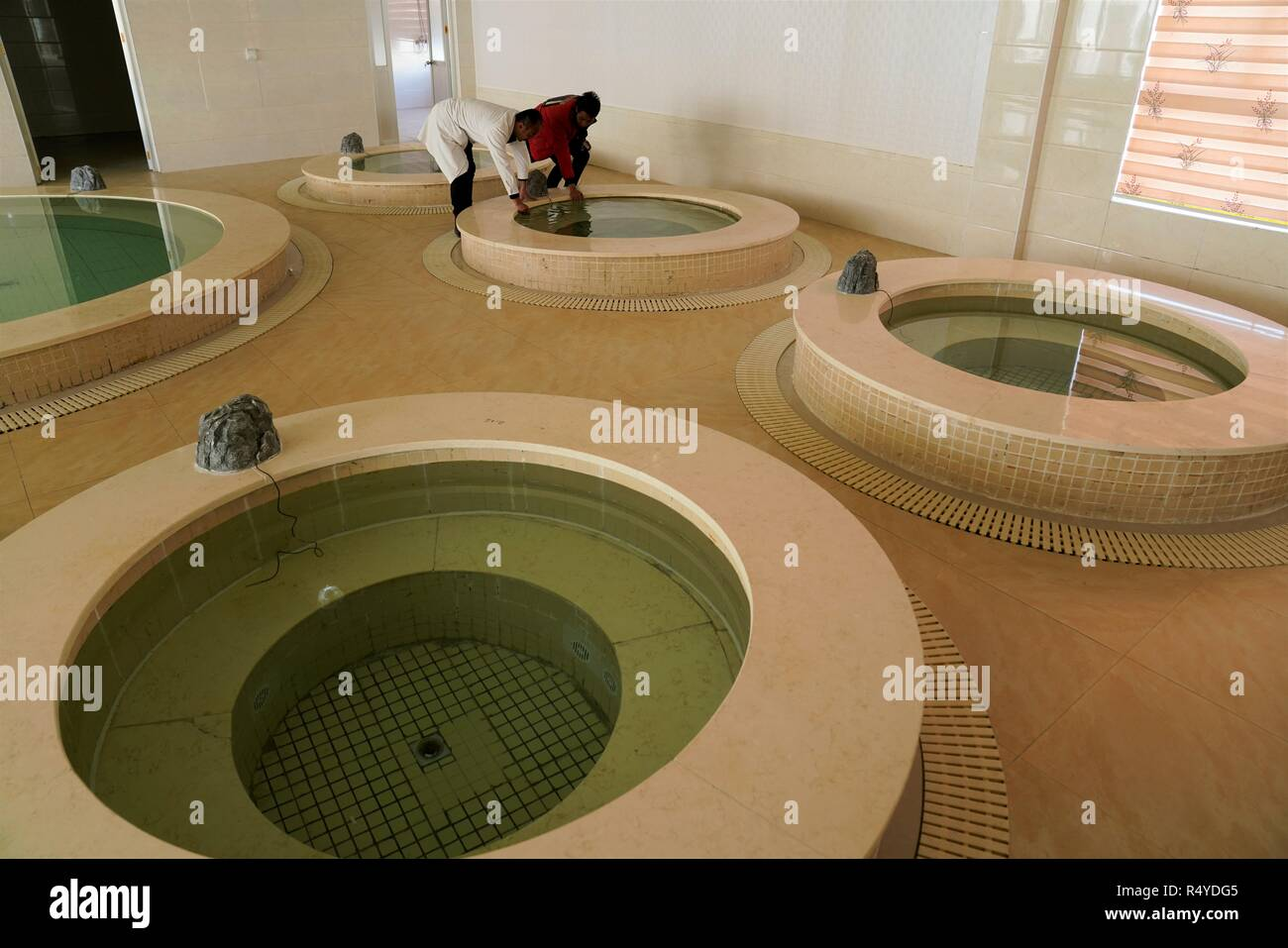 (181128) --  LHASA, Nov. 28, 2018 (Xinhua) -- Staff check the bath pools of Lum medicinal bathing of Sowa Rigpa at the Tibetan Medicine Hospital in southwest China's Tibet Autonomous Region, Nov. 21, 2018.     The United Nations Educational, Scientific and Cultural Organization (UNESCO) inscribed on Wednesday China's Lum medicinal bathing of Sowa Rigpa on the Representative List of the Intangible Cultural Heritage of Humanity, at a convention held in Port Louis, capital of the Republic of Mauritius.    The Lum medicinal bathing of Sowa Rigpa is knowledge and practices concerning life, health a - Stock Image