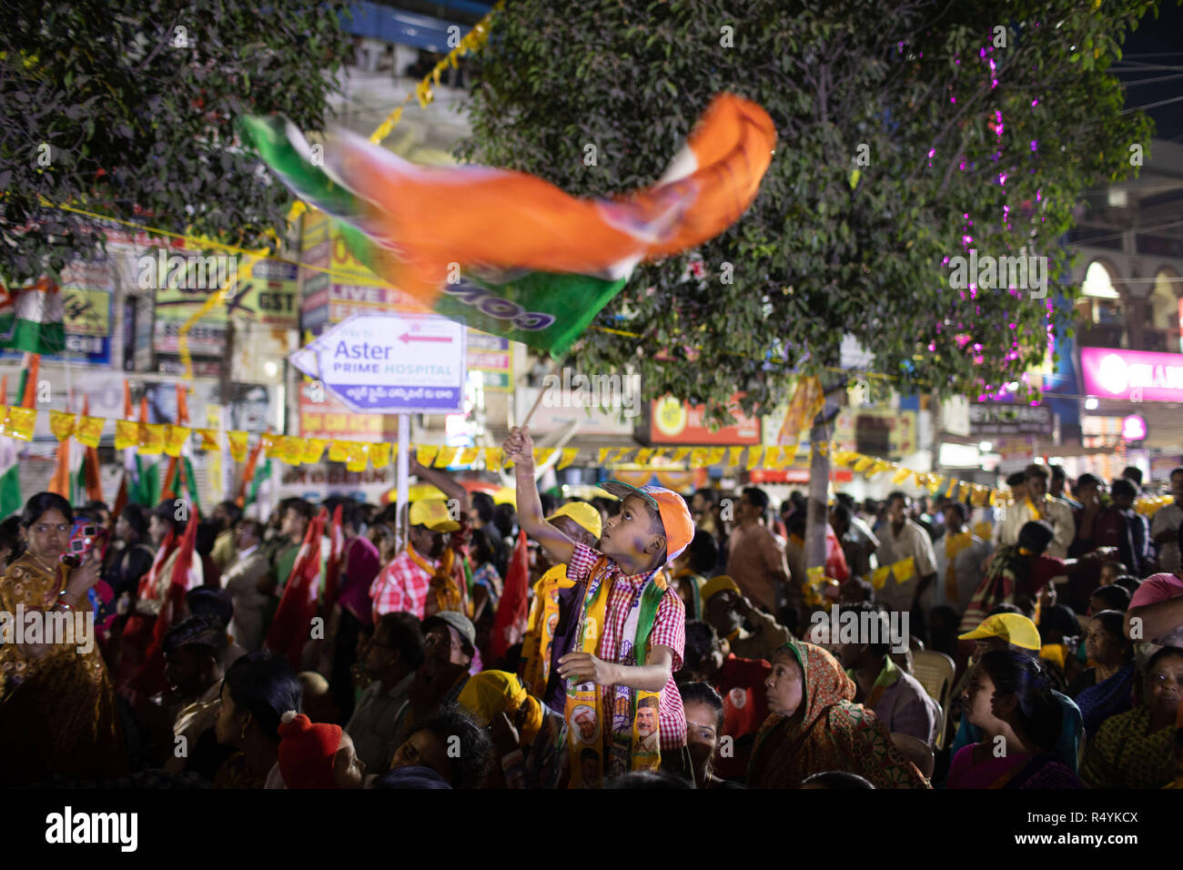 Hyderabad,India.28th November,2018. A young boy waves party flag of Indian National Congress  during a road show of Andhra Pradesh Chief Minister N Chandrababu Naidu and Congress President Rahul Gandhi in Hyderabad,India for the forthcoming Telangana Legislative Assembly elections to be held on 07 December,2018.Credit: Sanjay Borra/Alamy Live News - Stock Image
