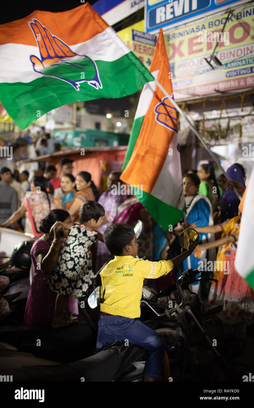 Hyderabad,India.28th November,2018. Supporters of Indian National Congress wave party flag during a road show of Andhra Pradesh Chief Minister N Chandrababu Naidu and Congress President Rahul Gandhi in Hyderabad,India for the forthcoming Telangana Legislative Assembly elections to be held on 07 December,2018.Credit: Sanjay Borra/Alamy Live News - Stock Image