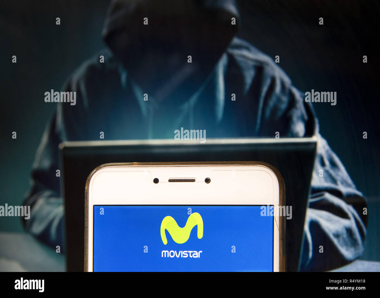 Hong Kong, China. 23rd Nov, 2018. Spanish telecommunications brand owned by Telefonica and largest mobile phone operator, Movistar, logo is seen on an Android mobile device with a figure of hacker in the background. Credit: Miguel Candela/SOPA Images/ZUMA Wire/Alamy Live News - Stock Image