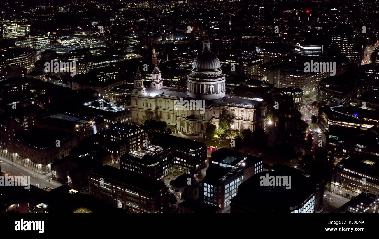 Aerial Night View of St. Paul's Cathedral in London. Birds Eye View Video feat. Religious Iconic Church and Tourism Landmark with traffic in London - Stock Image