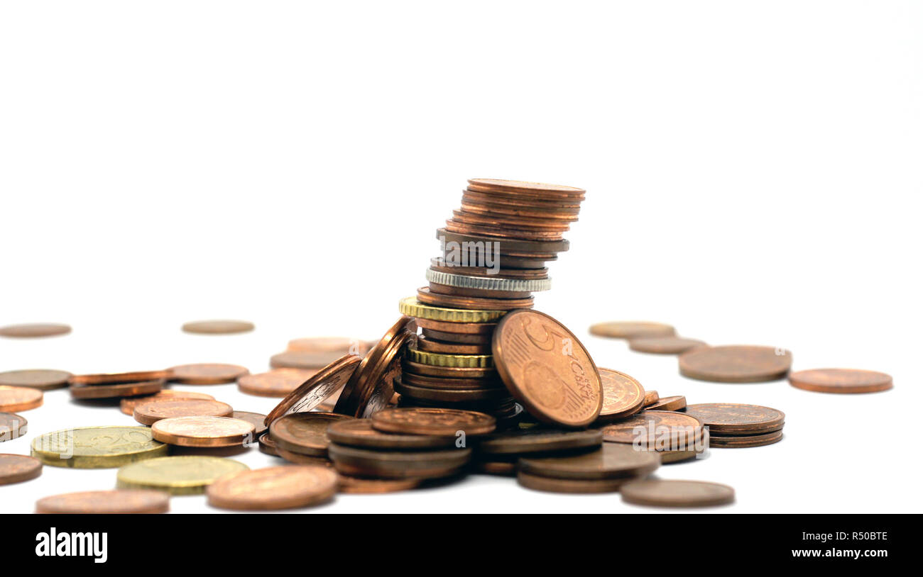 stack of coins at white background - Stock Image