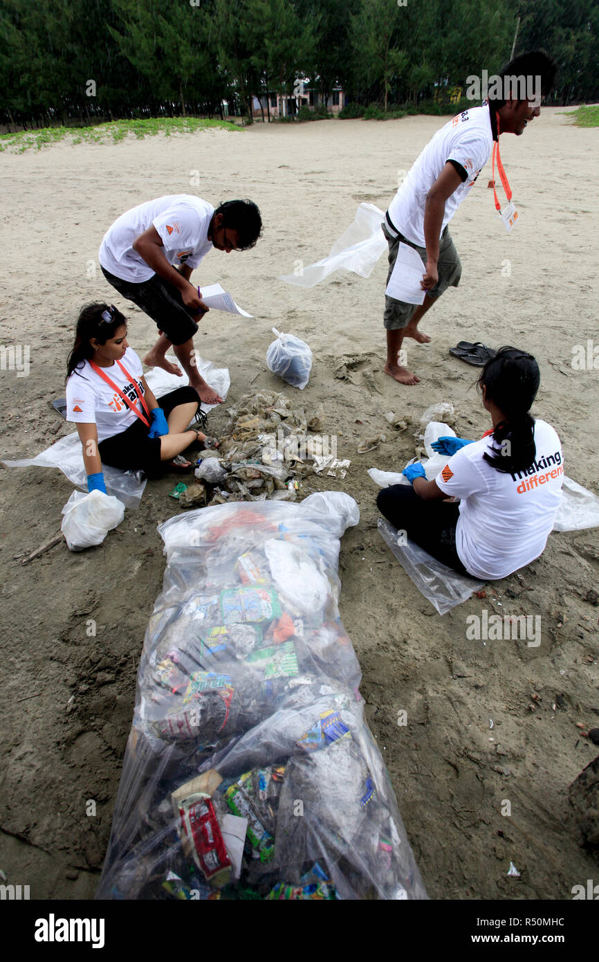The International Coastal Cleanup Day is observed in Cox's Bazar. People participate in removing trash and debris from different beaches and waterways - Stock Image