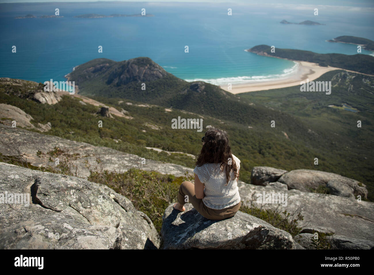 Girl looking the view on the top of Mt Oberon - Stock Image