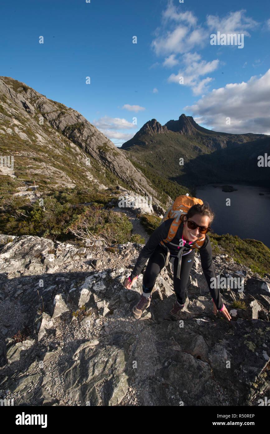 Female Adventurer hiking in Cradle Mountain National Park, Tasmania, Australia - Stock Image