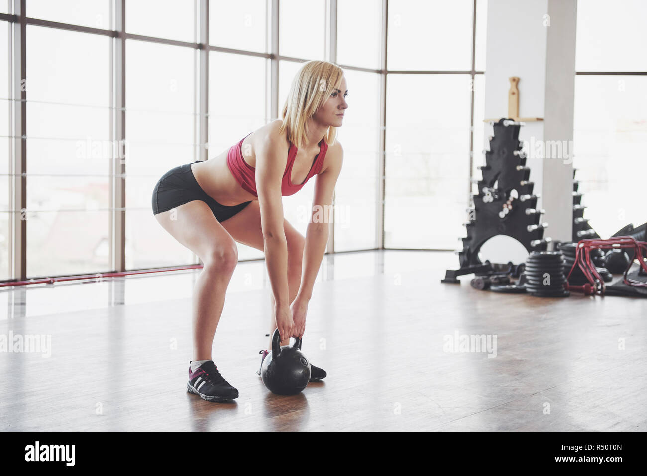 Active girl in fitness gym. Concept workout healthy lifestyle sport Stock Photo