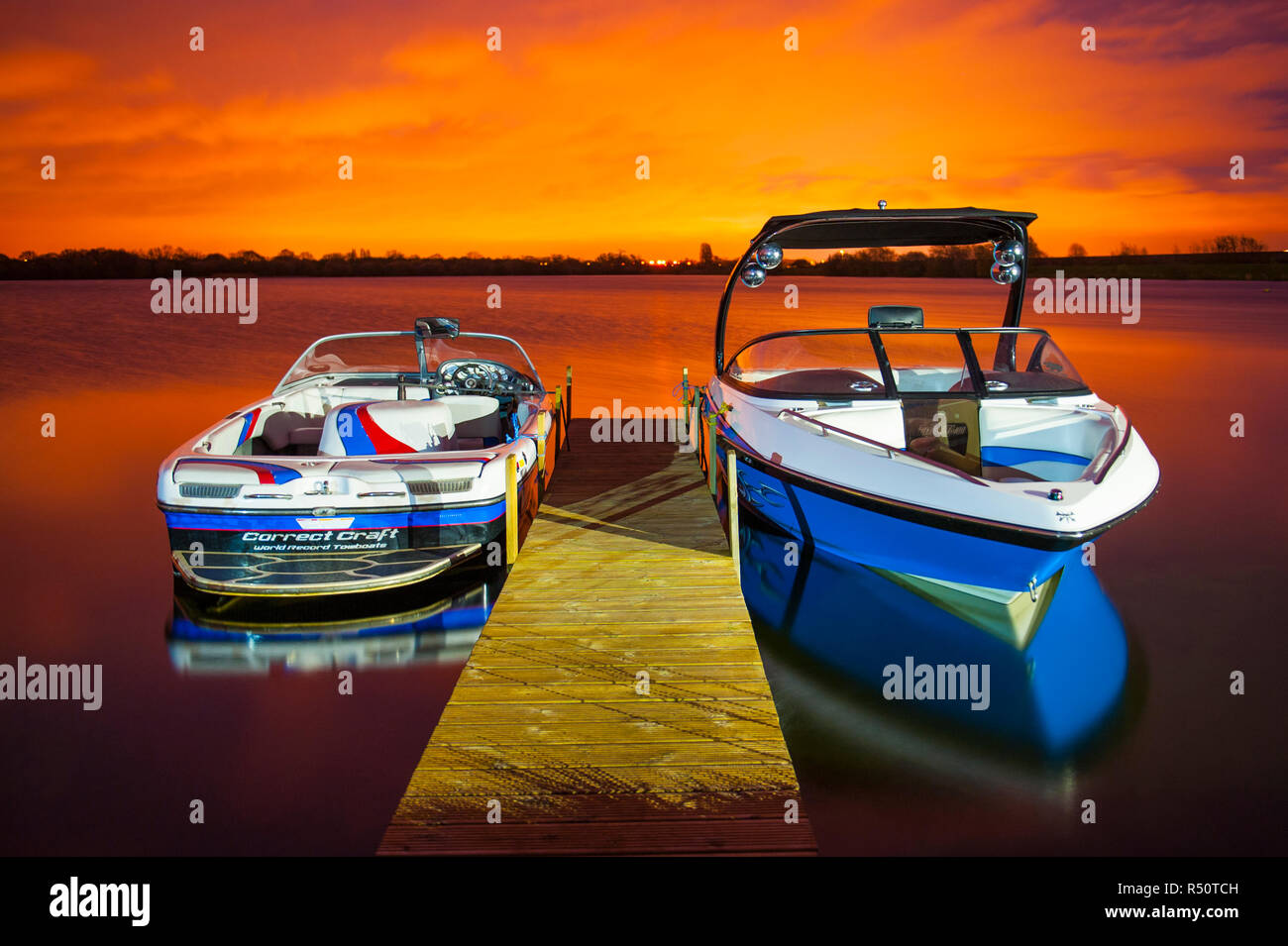 Wakeboarding Boats at Sunset - Stock Image