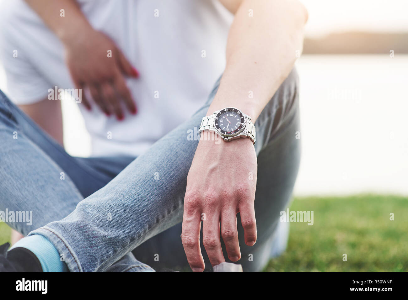 Men's hand with watch, free style - Stock Image
