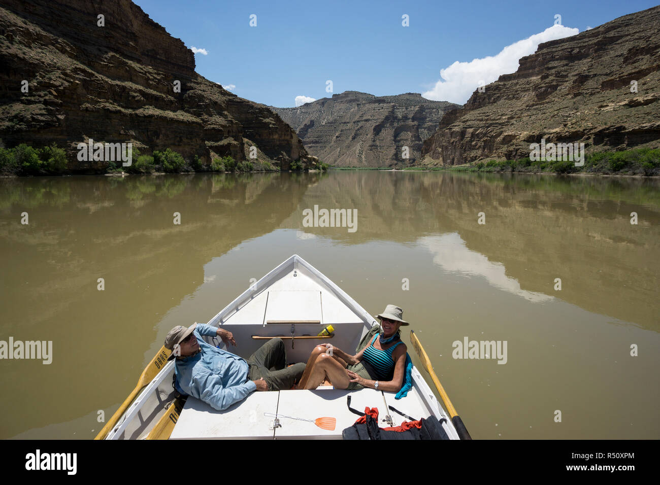 A Dory boat floats down the Desolation/Gray Canyon section of the Green river, Utah, USA Stock Photo
