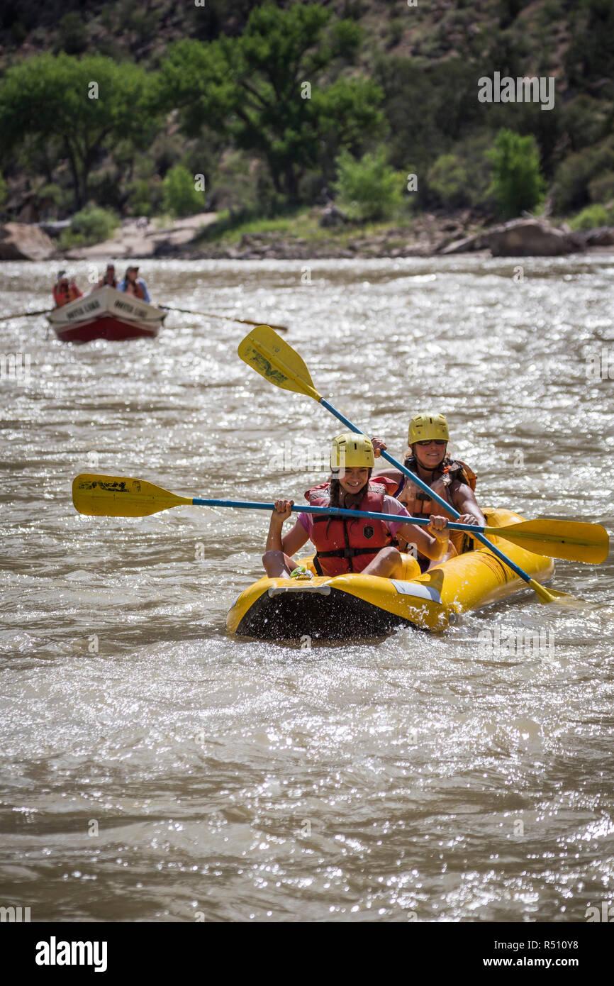 A young girl and her mother paddling an inflatable kayak, Green river rafting trip, Desolation/Gray Canyon section, Utah, USA - Stock Image