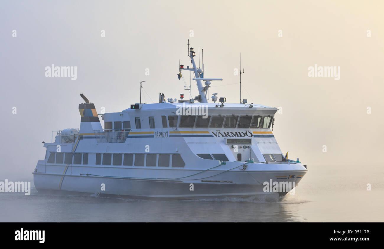 Commuter boat in foggy Stockholm archipelago, Sweden - Stock Image