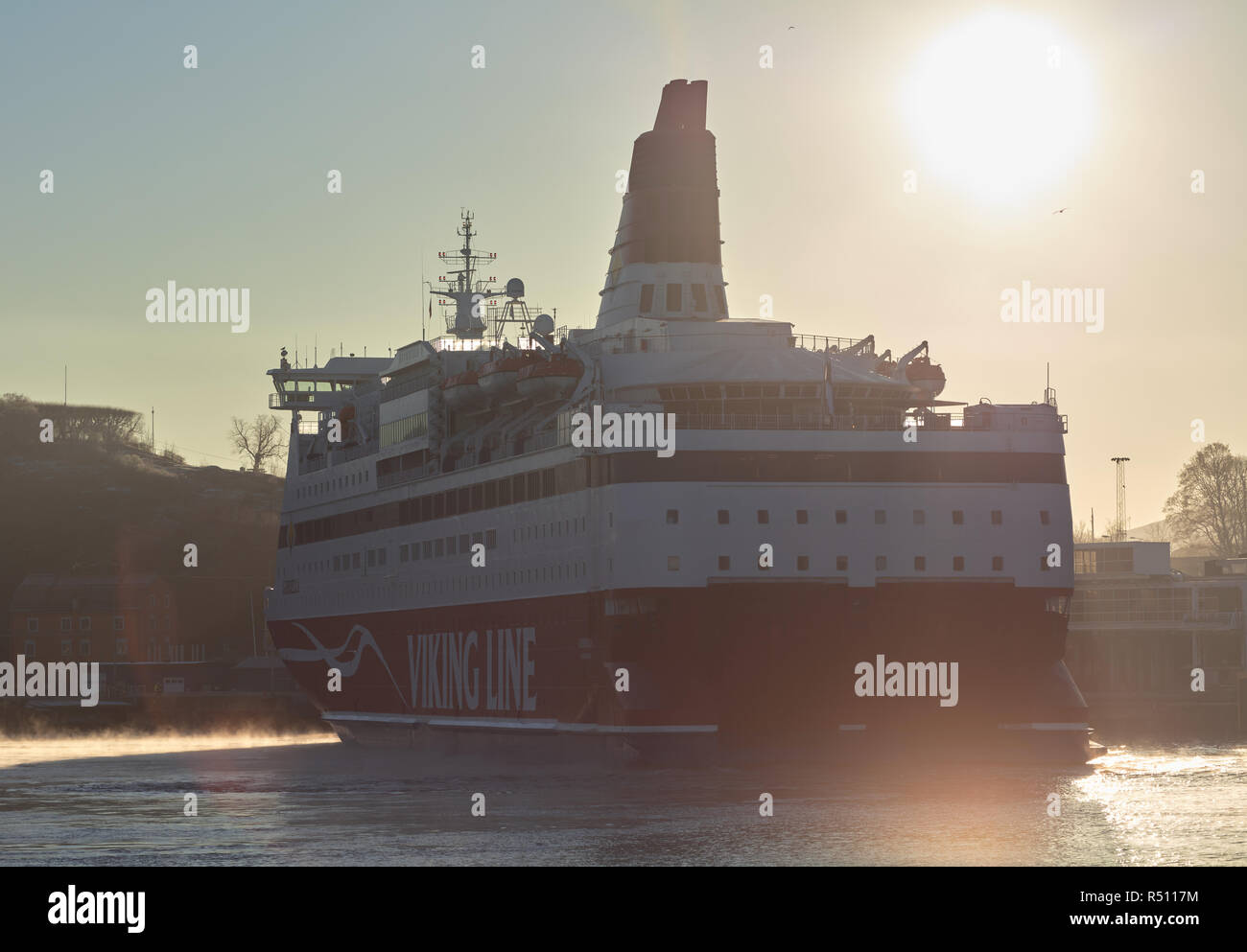 Viking Line ferry turning in foggy morning Stockholm harbor, Sweden - Stock Image