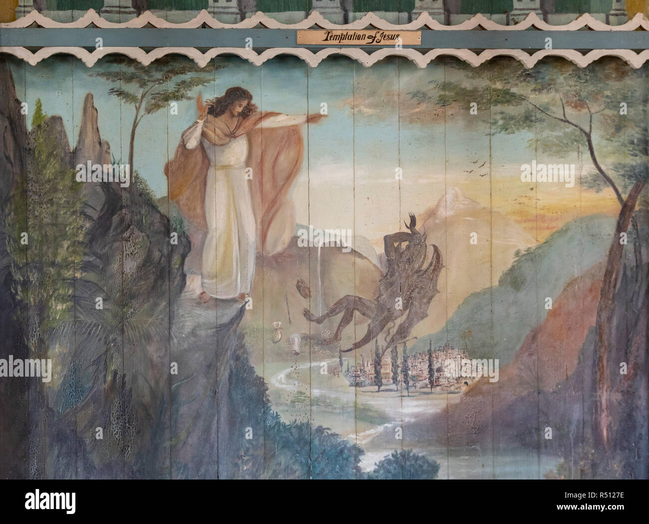 Honaunau, Hawaii - Temptation of Jesus, a painting on the wall of St. Benedict Roman Catholic Church, also known as The Painted Church. The church was - Stock Image