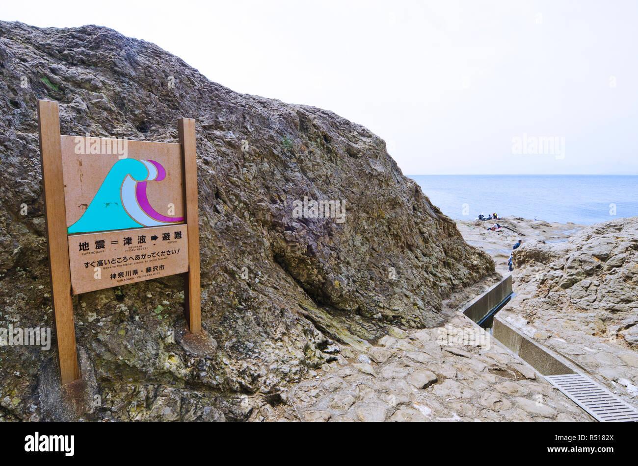 Tsunami Evacuation Route Sign on Enoshima island, Kanagawa Prefecture, Japan - Stock Image