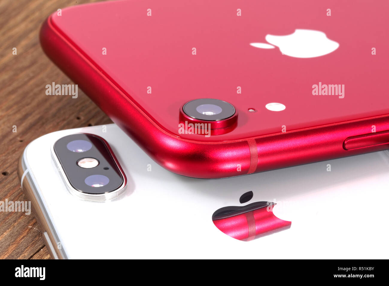 Koszalin, Poland – November 29, 2018: Silver iPhone Xs and red iPhone XR. The iPhone Xs and iPhone XR is smart phone with multi touch screen produced - Stock Image