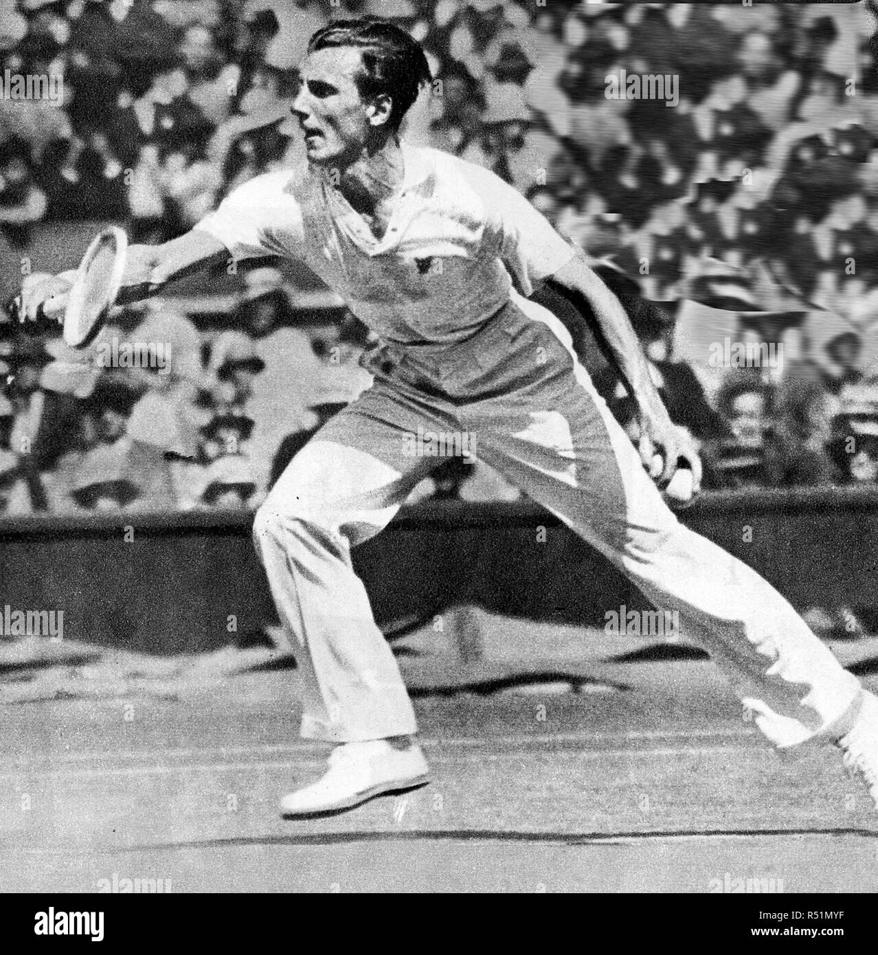 1934, Britain's men's Wimbledon tennis champion Fred Perry who beat Australian, J Crawford - Stock Image